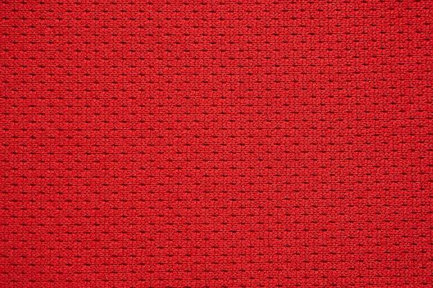 Texture de maillot de football tissu vêtements de sport rouge bouchent