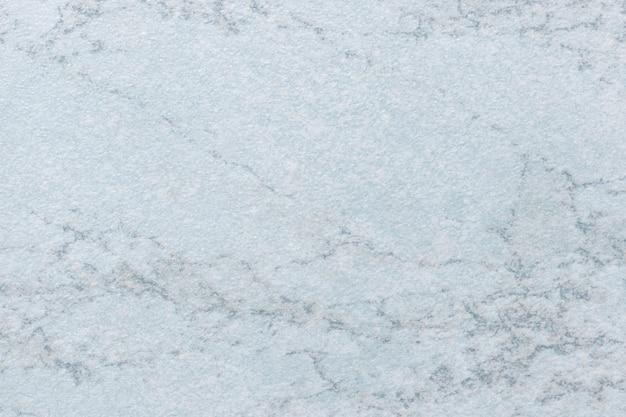 Texture de marbre bleu clair avec motif, fond macro. pierre de couleur acier pastel à partir de carreaux minéraux.
