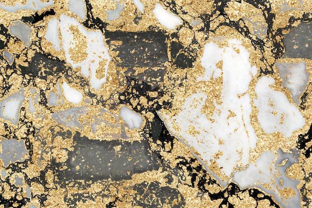 Texture de marbre noir et feuille d'or