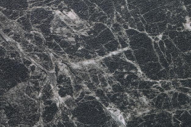 Texture de marbre noir avec des lignes blanches
