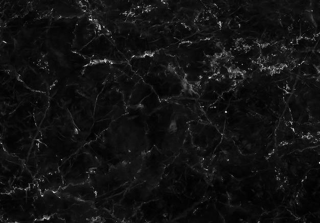 Texture de marbre noir naturel pour fond luxueux de carreaux de peau, pour le travail d'art de conception.
