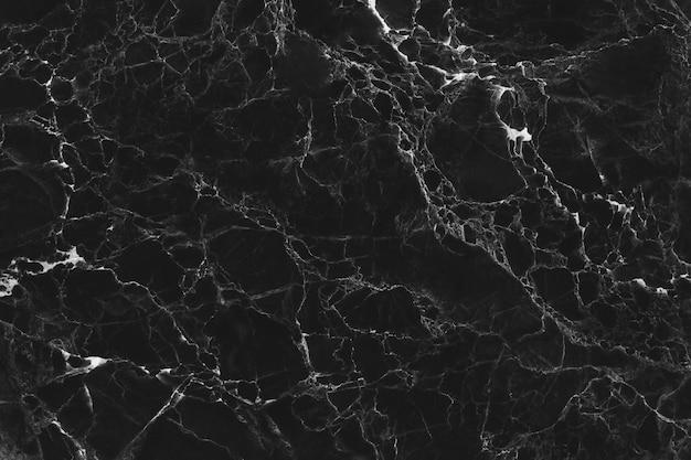 Texture de marbre noir pour la conception décorative de fond ou de carreaux de sol.