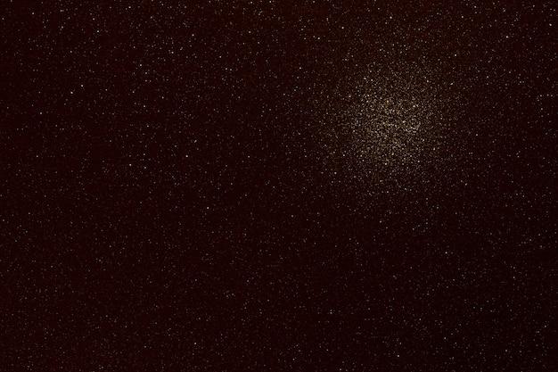Texture marron foncé avec paillettes et tache de lumière