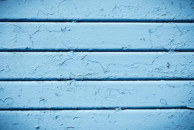 Texture de métal vieux peint bleu fissuré.