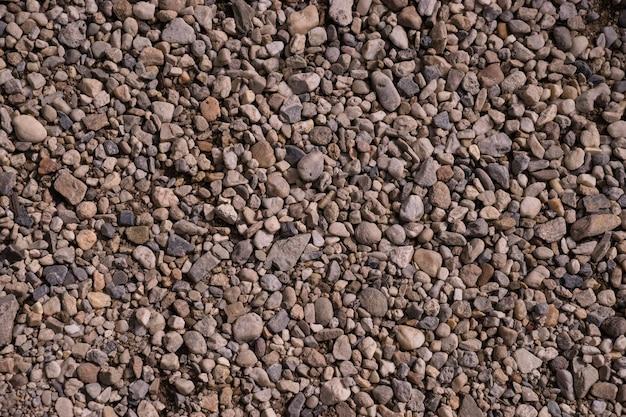 Texture de modèle de petit fond blanc et gris de roches et de pierres
