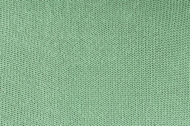 Texture monochrome du tricot. beau fond blanc avec des boucles.