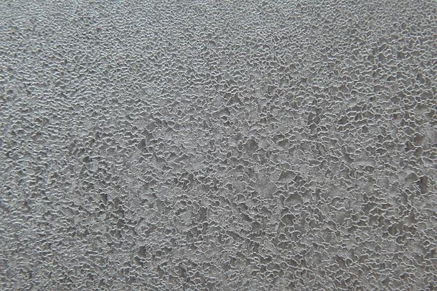 Texture de motifs givrés sur le gros plan de la fenêtre