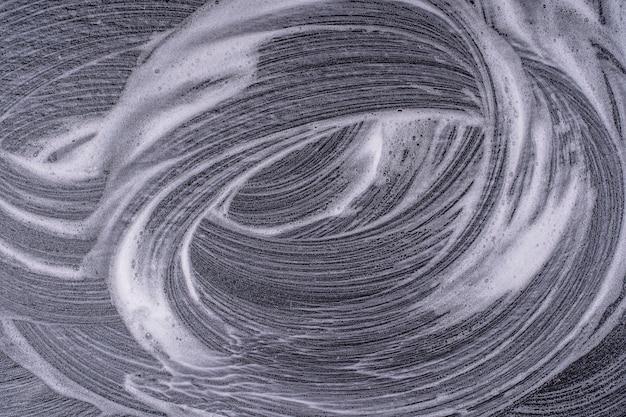 Texture mousse abstraite sur fond noir. bulles de mousse de savon abstrait fond sombre, vue de dessus