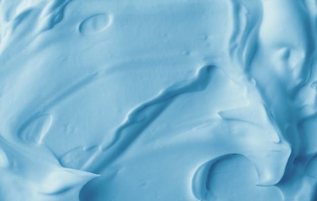 Texture de mousse cosmétique bleue