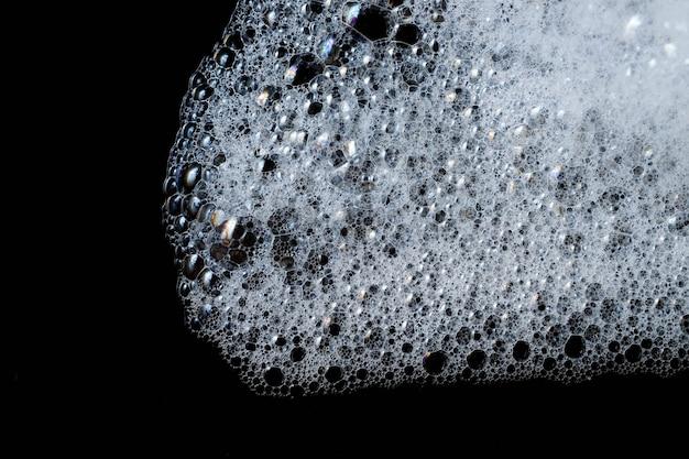 Texture de mousse savonneuse blanche abstrait. shampooing mousse avec des bulles