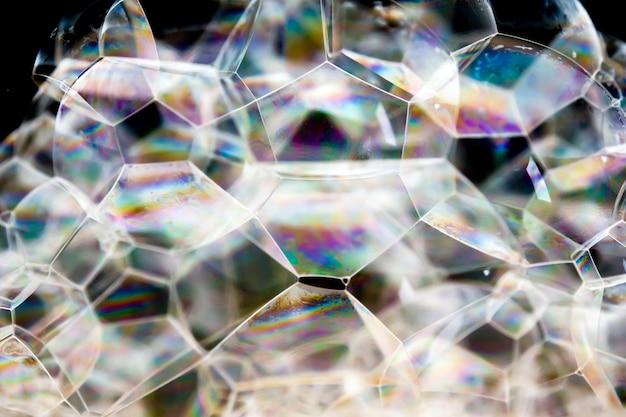 Texture de mousse savonneuse fond abstrait. shampooing mousse à bulles