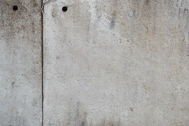 Texture de mur en béton ancien. fond de ciment