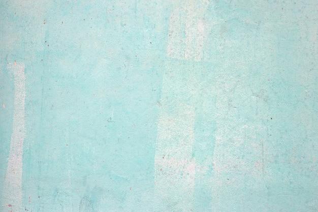 Texture de mur de béton bleu pour le fond.