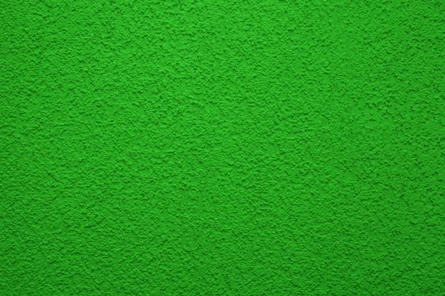 Texture de mur en béton brillant et coloré, fond peint - couleur verte. papier peint en plâtre.