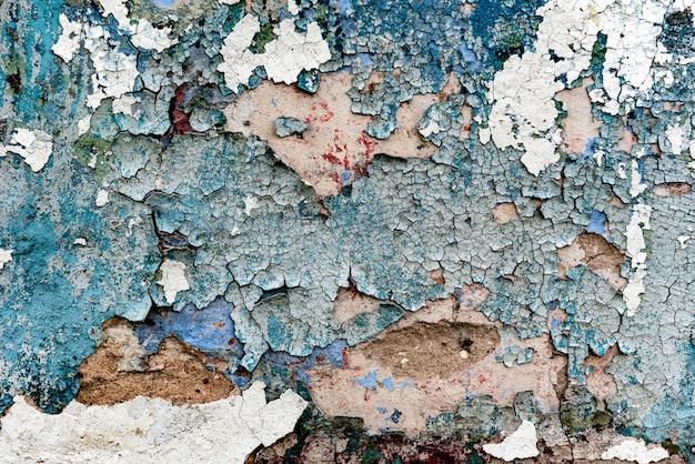 Texture d'un mur en béton avec fissures et rayures