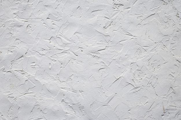 Texture de mur de béton gris. mur de ciment grunge, matériel. modèle moderne pour le design décoratif. toile de fond grise. éléments intérieurs et extérieurs. abstrait. sol rugueux en béton inégal.