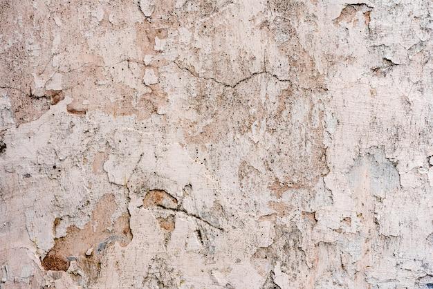 Texture, mur, béton, il peut être utilisé comme arrière-plan. fragment de mur avec rayures et fissures