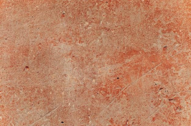 Texture d'un mur de béton rouge.