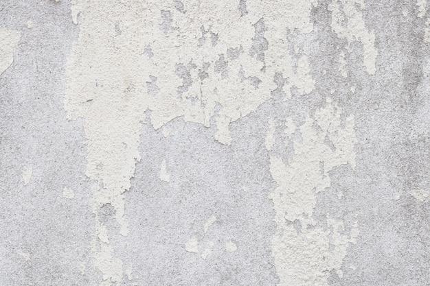 Texture de mur blanc vieux avec craquelé et pelé dans un style vintage pour le travail de l'art de fond et de conception.