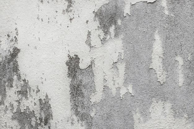 Texture de mur blanc vieux avec craquelé et pelé