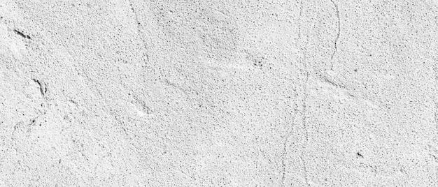 Texture de mur blanchi à la chaux rugueux. texture de mur de béton gris