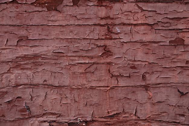 Texture de mur en bois vieux rouge foncé peint, fond rustique