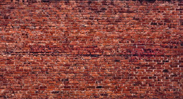 Texture de mur de brique ancienne usine. contexte architectural vintage