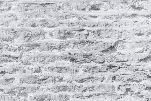 Texture de mur de brique de béton pierreux