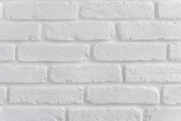 Texture de mur de brique blanche moderne pour le fond.