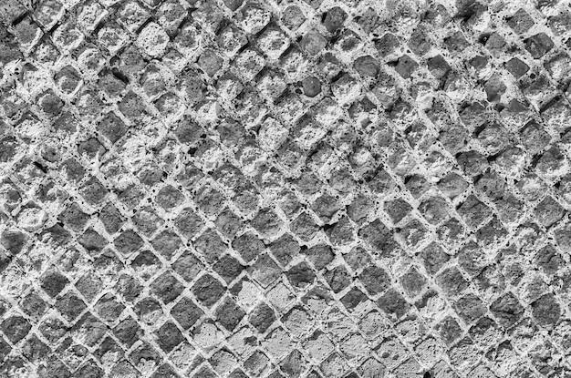 Texture de mur de brique en pierre noire et blanche, peut utiliser comme arrière-plan