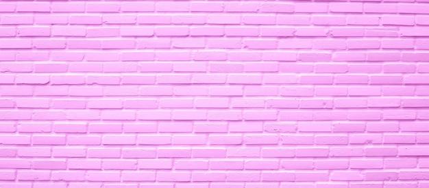 Texture de mur de brique rose pour le fond.