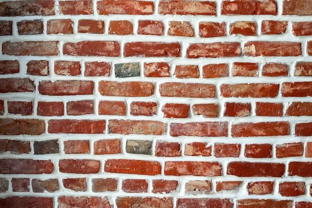 Texture de mur de brique rouge avec coulis blanc, vintage, mur de grunge