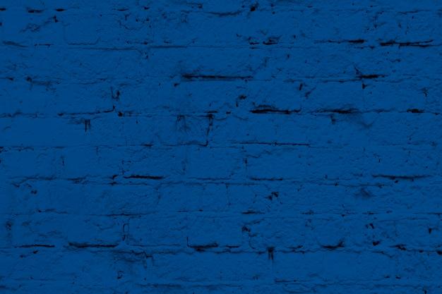 Texture de mur de briques blanches modernes en bleu classique