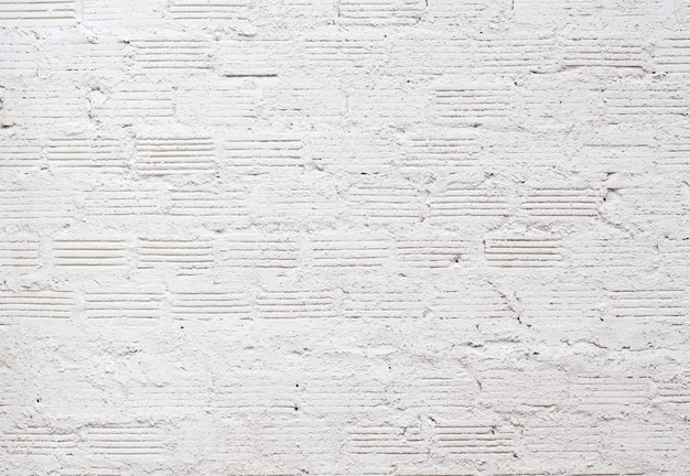 Texture de mur de briques blanches pour l'arrière-plan