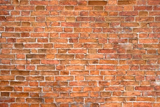 Texture de mur de briques patinées, vieux fond pour la conception ou l'intérieur