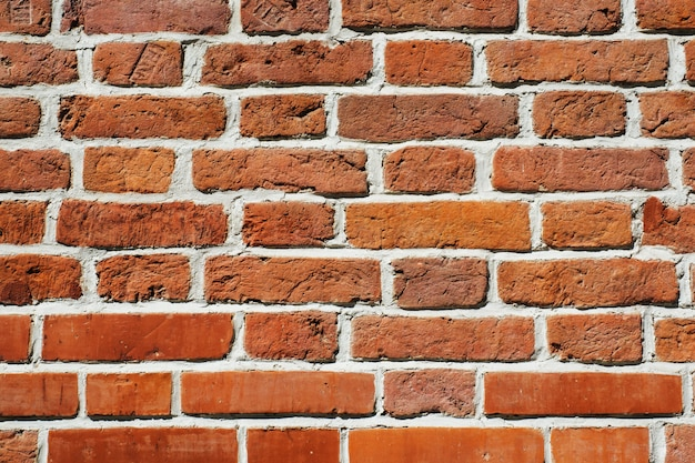 Texture de mur de briques rouges, fond de pierre
