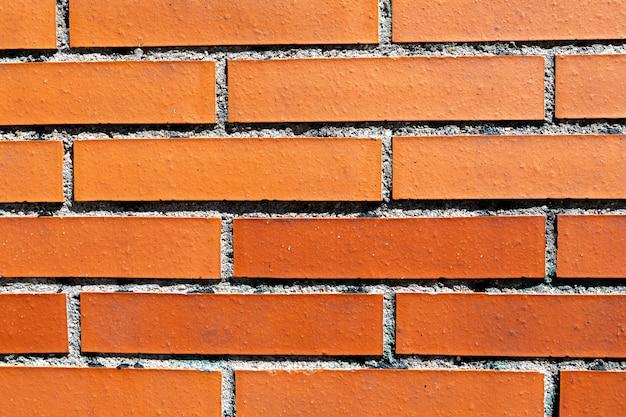 Texture de mur de briques rouges pour le fond