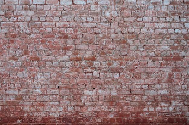 Texture de mur de briques vieilli et teinté
