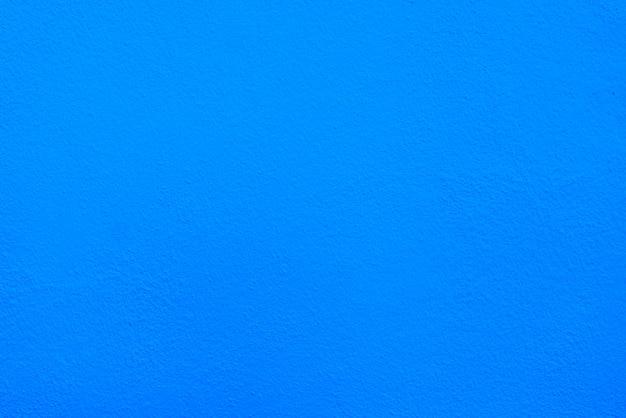 Texture de mur de ciment ou de béton bleu pour le fond.