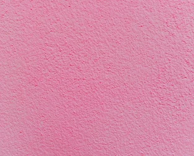 Texture de mur de ciment ou de béton rose pour le fond.