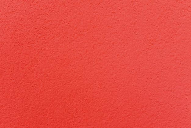 Texture de mur de ciment ou de béton rouge pour le fond