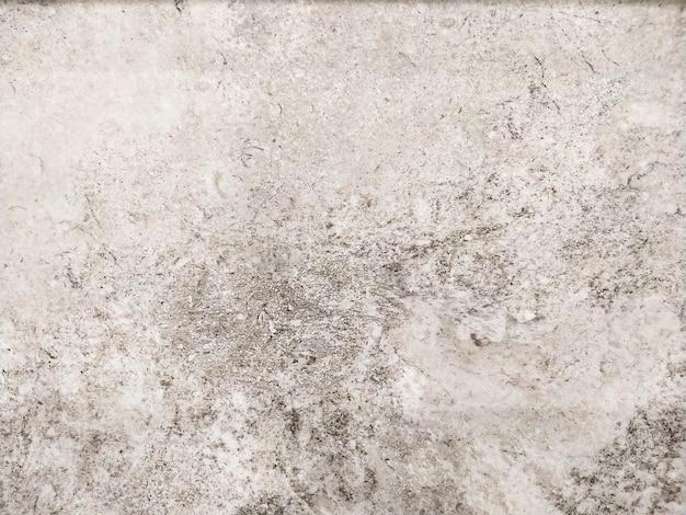 Texture de mur de ciment gris ou fond de pierre.