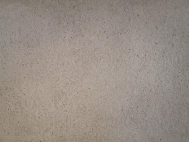 Texture de mur de ciment grunge beige abstrait.
