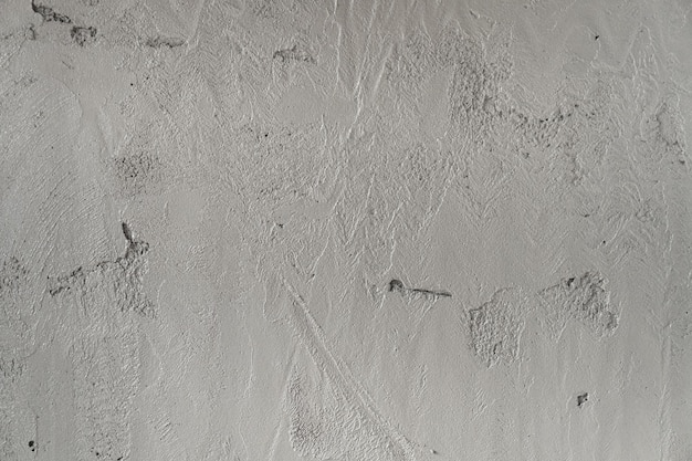 Texture de mur de ciment humide dans la construction de bâtiments pour le fond
