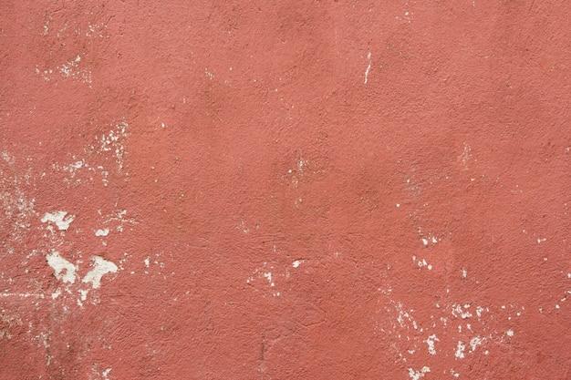 Texture de mur de ciment rouge vieux