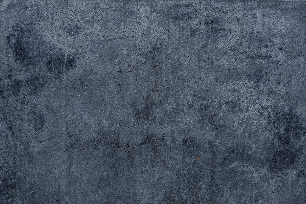 Texture de mur en ciment texturé fond noir béton texturé