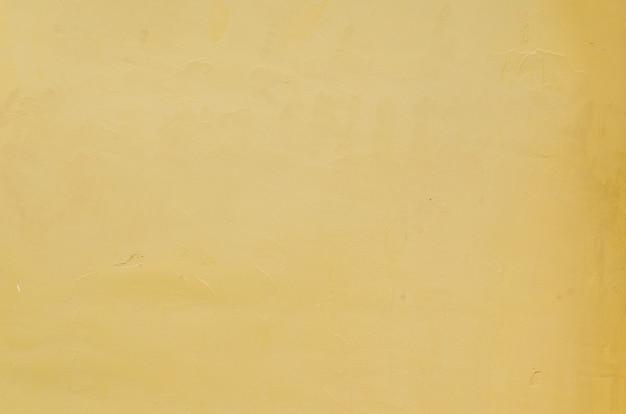 Texture de mur concerte jaune et fond