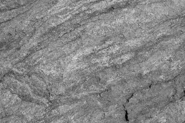 Texture de mur gris rugueux granit avec fissure.