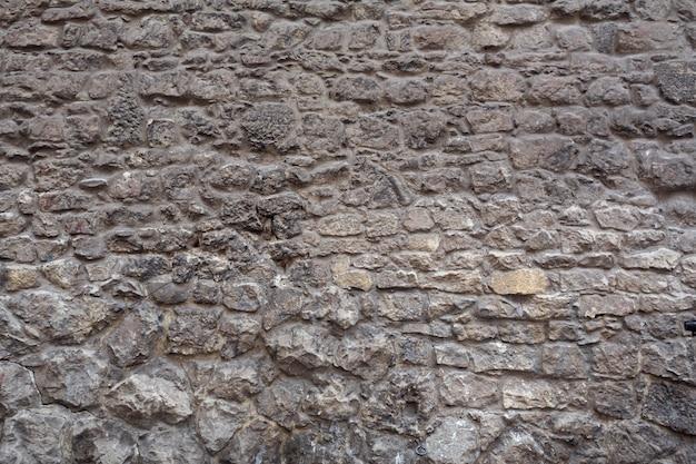 Texture. mur de maçonnerie. bâtiment historique de près.
