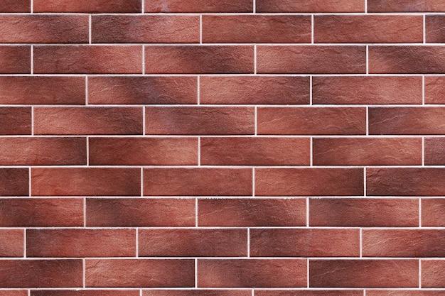 Texture de mur marron de carreaux décoratifs ou de briques.